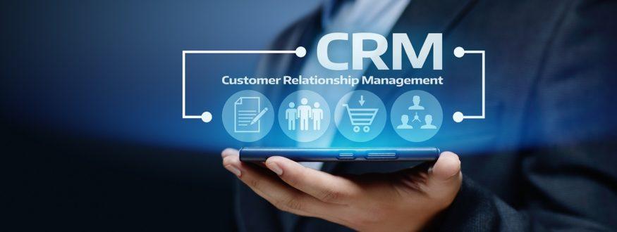 Man holding digital rendering of CRM